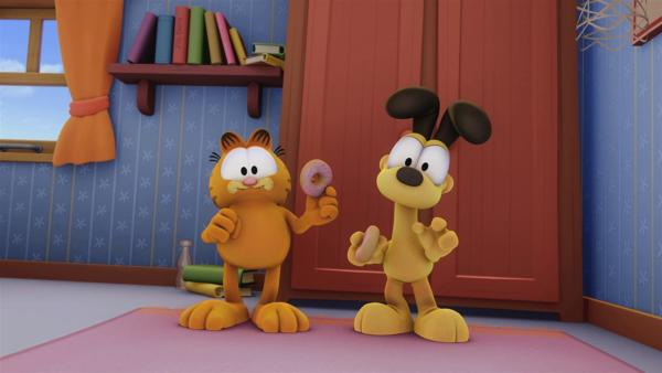 Jon hat Garfield einen seiner Geburtstags-Donuts abgegeben, doch das reicht dem verfressenen Kater nicht. | Rechte: HR/Dargaud Media/MediaToon/Paws Inc./France 3