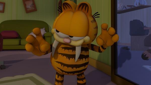 Garfield, als Katzilla verkleidet, erschreckt etliche Nachbarn fast zu Tode. | Rechte: HR/DARGAUD MEDIA