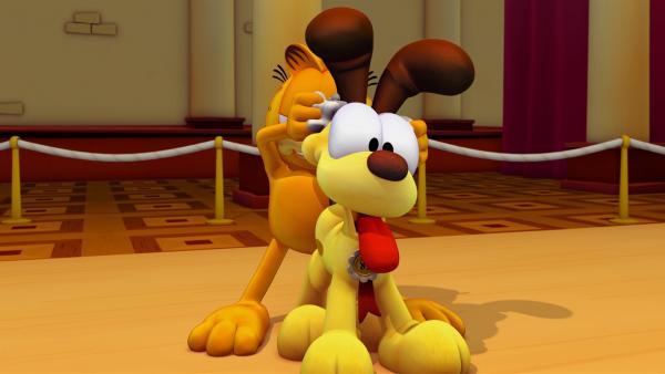 Garfield beschließt, dass Odie beim Wettbewerb mitmachen soll und ernennt sich zu seinem Manager.   Rechte: HR/DARGAUD MEDIA