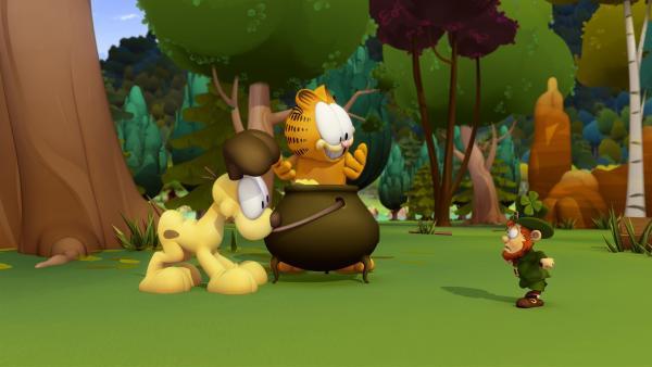 Odie findet Gold. Der Kobold, der es bewacht, will es zurück und bietet Garfield im Tausch einen Glückszauber an.   Rechte: HR/DARGAUD MEDIA