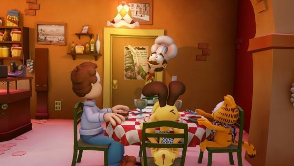 Garfield und Odie verkleiden sich als Jons Töchter, um in die Pizzeria zu kommen, in der Jon mit Liz zu Abend isst. | Rechte: HR/DARGAUD MEDIA