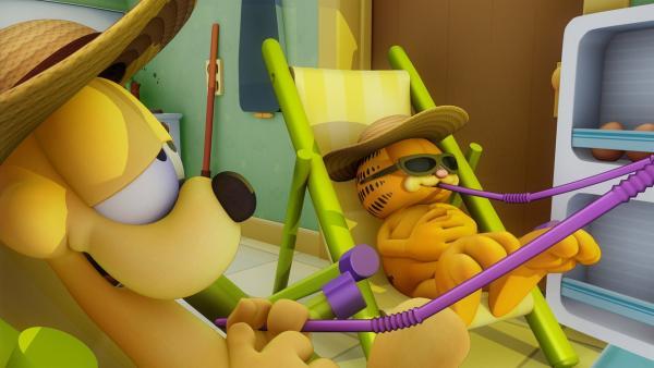 Eine Hitzewelle legt das ganze Land lahm. Odie und Garfield versuchen sich so gut wie möglich abzukühlen.   Rechte: HR/DARGAUD MEDIA