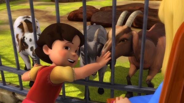 Heidi streichelt die Ziegen.   Rechte: ZDF/Studio 100 Animation/Heidi Productions Pty. Limited