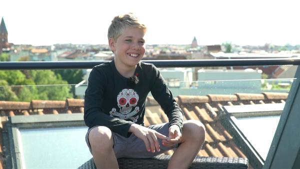 Der 13-jährige Rapper Morten aus Berlin tauscht sein Hobby. | Rechte: MDR/Cine Impuls