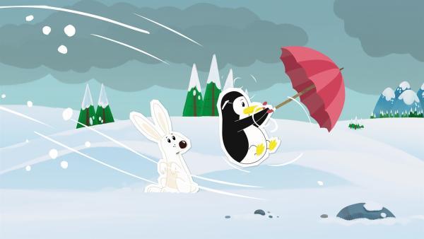 Pinguindame Lissy hat sich von Inui wegen des schlechten Wetters einen Schirm geliehen. Der Sturm bläst sie damit aber wie wild durch die Gegend. Loslassen kommt für sie bei etwas Geliehenem nicht in Frage. | Rechte: ZDF und JEP-Animation GmbH