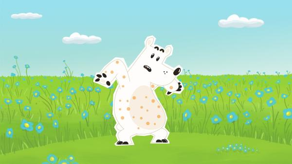 Als Eisbär Grumpel nach einem Nickerchen in einer Wiese aufwacht, ist er über und über mit kleinen hellbraunen Punkten bedeckt. Ob er etwa die gefährlichen und ansteckenden Bären-Masern bekommen hat?   Rechte: ZDF und JEP-Animation GmbH