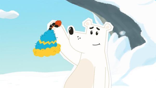 Grumpel ist begeistert: Irgendjemand hat ihm eine warme Mütze gestrickt und in die Nähe seiner Höhle gelegt. Aber wer war das wohl? Das will er nun unbedingt herausfinden – denn da scheint ihn jemand sehr zu mögen. | Rechte: ZDF und JEP-Animation GmbH