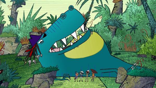 Gigantosaurus hat einen dicken aufgeblähten Bauch und kann sich nicht mehr bewegen. Er bittet Flinn und seine Leute (klein vor ihm) um Hilfe.   Rechte: ZDF/SRL Productions/Telegael Teoranta