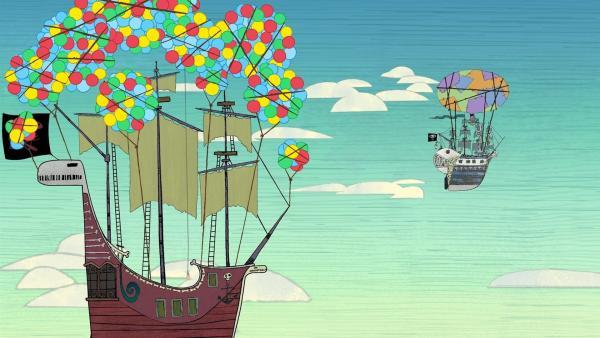 Viele bunte Luftballons haben das Piratenschiff (v.) aufsteigen lassen. Auch die Walnuss (h.)hat sich in die Lüfte erhoben, mittels eines Heißluftballons.   Rechte: ZDF/SRL Productions/Telegael Teoranta