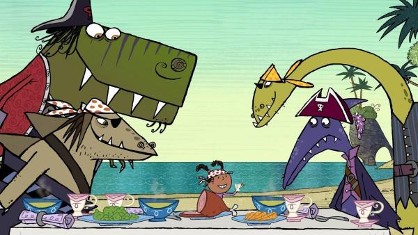 Ruby (Mi.) demonstriert den Dinopiraten T-Rex, Stöcki, Terry und Dippy, wie man manierlich speist.   Rechte: ZDF/SRL Productions/Telegael Teoranta