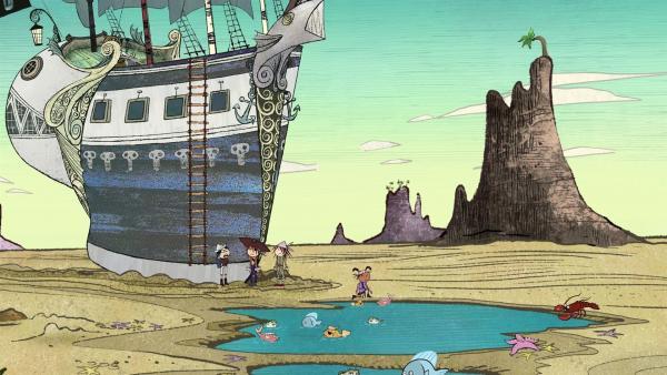 Die Walnuss ist gestrandet. Wo das Meer war, sind nur noch Tümpel. Tom, Flinn, Wilma und Ruby beratschlagen, was zu tun ist.   Rechte: ZDF/SRL Productions/Telegael Teoranta