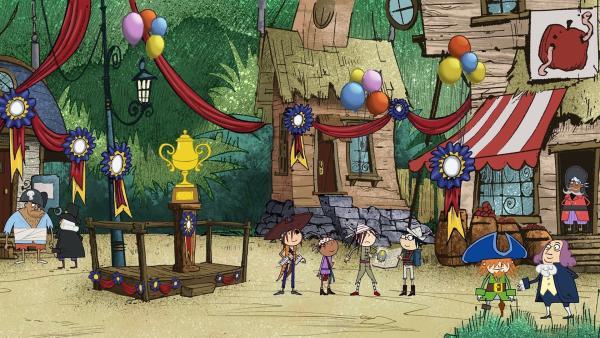 Im Shanty-Dorf ist der Pokal aufgebaut, den Flinn, Ruby, Wilma und Tom (v.l.n.r.) beim Schiffsrennen gerne gewinnen möchten. | Rechte: ZDF/SRL Productions/Telegael Teoranta