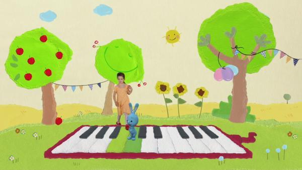 Kikaninchen spielt auf der Melodica | Rechte: KiKA