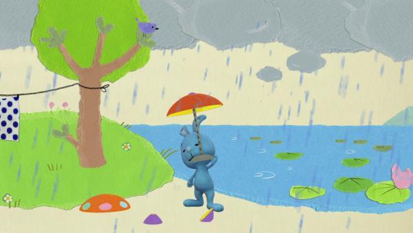 Kikaninchen baut sich einen Brummkreiselregenschirm | Rechte: KiKA