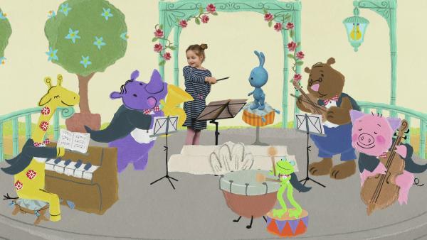 Yenne dirigiert ein Orchester | Rechte: KiKA