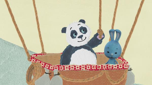 Kikaninchen fährt mit einem Heißluftballon und einem Panda zu einem Drachenfest | Rechte: KiKA