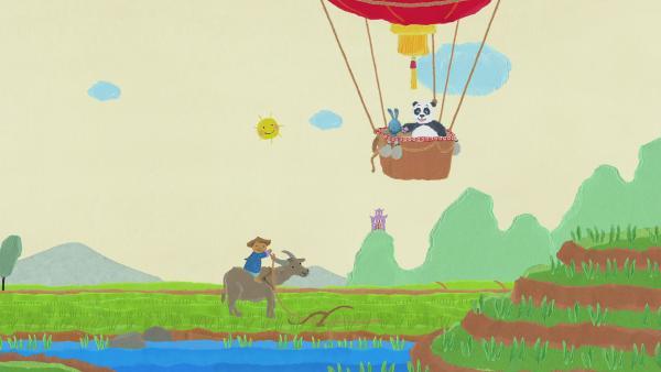 Kikaninchen fährt mit einem Panda in einem Heißluftballon auf die Reisfelder | Rechte: KiKA