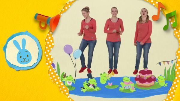 Anni singt den Fröschekanon. Die Frösche feiern ein Fest am See und singen gemeinsam: Quak, Quak!  | Rechte: KiKA