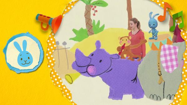 Kikaninchen, Anni und Christian stimmen mit Affe, Nashorn und Elefant das Trötenflötentrommellied an. Sie spielen Instrumente und singen dazu. | Rechte: KiKA