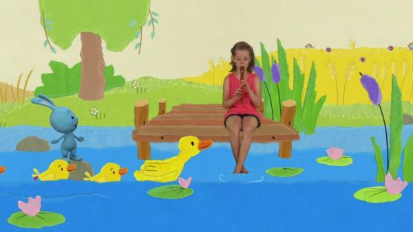 Kikaninchen und die Entenfamilie baden am See | Rechte: KiKA