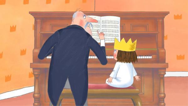 Der Premierminister gibt der kleinen Prinzessin Klavierunterricht.   Rechte: ZDF/Illuminated Film Company