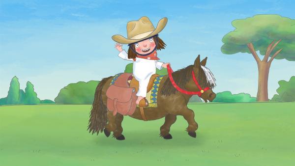 Die kleine Prinzessin hat sich als Cowgirl zurechtgemacht und will nun auf Ferdinand, ihrem Pferd, Rinder hüten. | Rechte: ZDF/The Illuminated Film Company