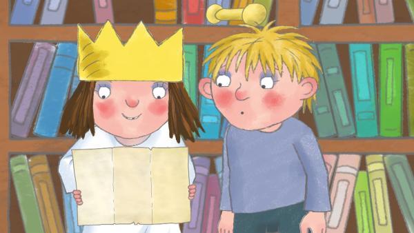 In einem alten Buch haben die Prinzessin und Alfi eine Schatzkarte gefunden. | Rechte: ZDF/The Illuminated Film Company