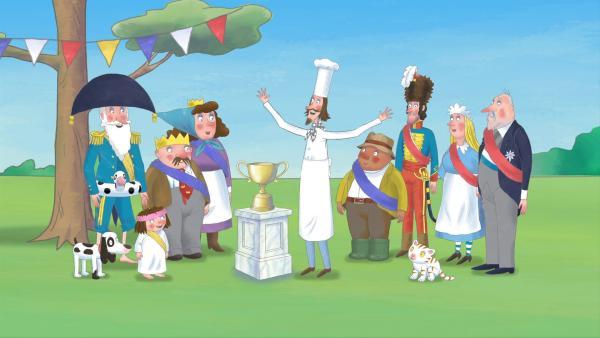 Der Koch ist der Preisrichter beim Sportfest und überreicht den Pokal. | Rechte: ZDF/illuminated