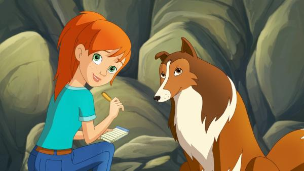 Zoe schreibt eine Nachricht an ihre Mutter, die sie von Lassie überbringen lassen will. | Rechte: ZDF/Classic Media/DC Entertainment/Superprod