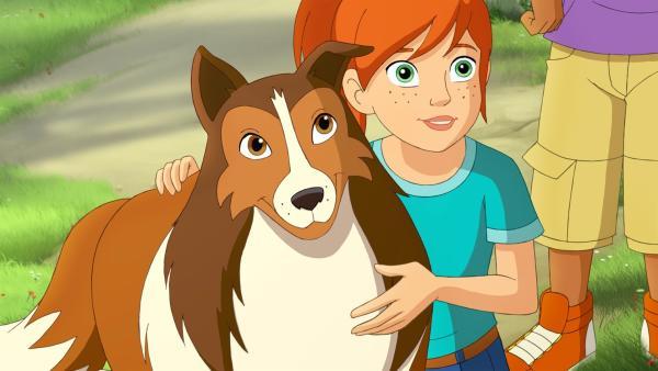 Zoe ist froh, dass ihre Hündin Lassie wieder unversehrt zurückgekehrt ist. | Rechte: ZDF/Classic Media/DC Entertainment/Superprod