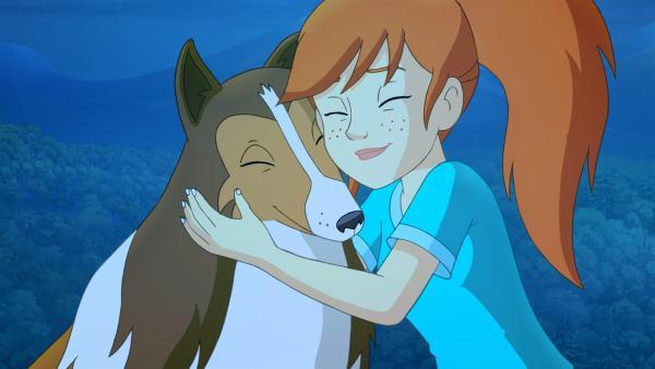 Zoe bedankt sich bei Lassie für ihre Rettung. | Rechte: ZDF/Classic Media/DC Entertainment/Superprod