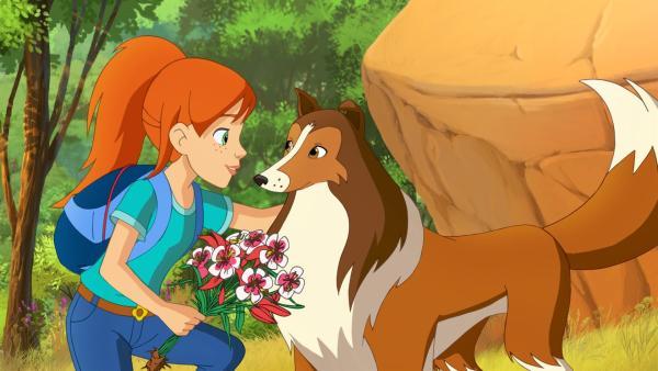"""Zoe freut sich, dass Hündin Lassie einen weiteren Weg in den """"geheimen"""" Garten gefunden hat.   Rechte: ZDF/Classic Media/DC Entertainment/Superprod"""