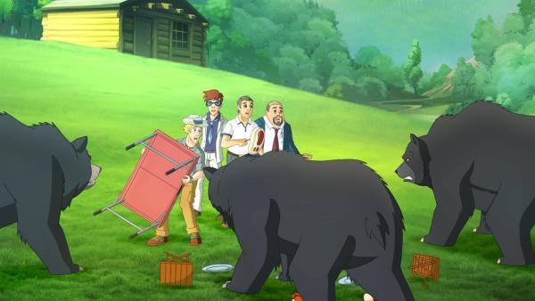 Harvey (2. von rechts) und seine hinterhältigen Investoren werden von Bären angegriffen, die es auf die Steaks abgesehen haben.  | Rechte: ZDF/Classic Media/DC Entertainment/Superprod