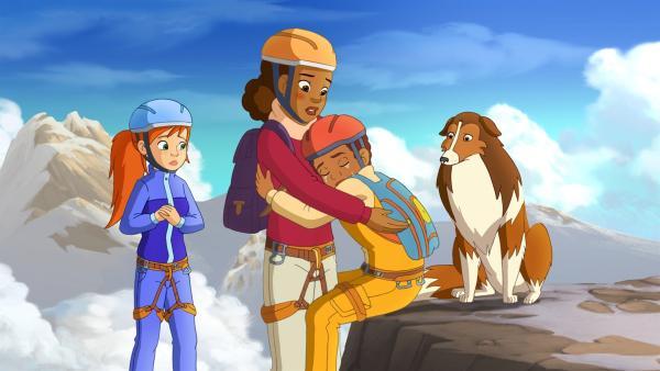 Zoe (li.), Beth (2.v.li.) und Lassie haben Harvey erschöpft und verzweifelt an einem Berghang gefunden.  | Rechte: ZDF/Classic Media/DC Entertainment/Superprod