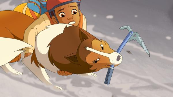 Harvey rutscht eine vereiste Felswand hinab. Lassie versucht ihn zu retten. | Rechte: ZDF/Classic Media/DC Entertainment/Superprod