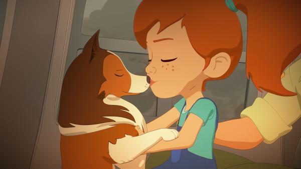 Endlich in Sicherheit vor den Bränden bedankt sich die kleine Zoé mit einem Küsschen bei der kleinen Lassie, die durch ihre Klugheit und Beherztheit maßgeblich zur Rettung beigetragen hat. | Rechte: ZDF/Superprod/ZDFE