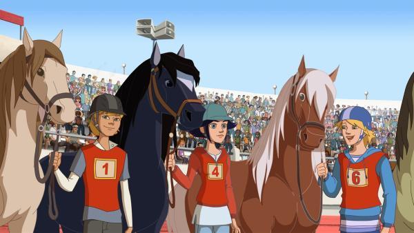 Beim Turnier am Start: (v.l.) ein Reiter, Lena und Nico.   Rechte: hr/Télé Images