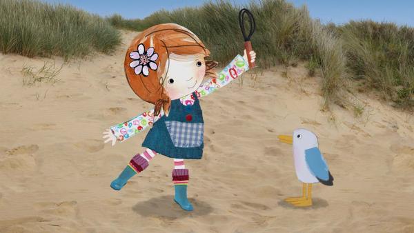 Lily hat am Strand einen Quirl gefunden. | Rechte: KiKA/Sixteen South
