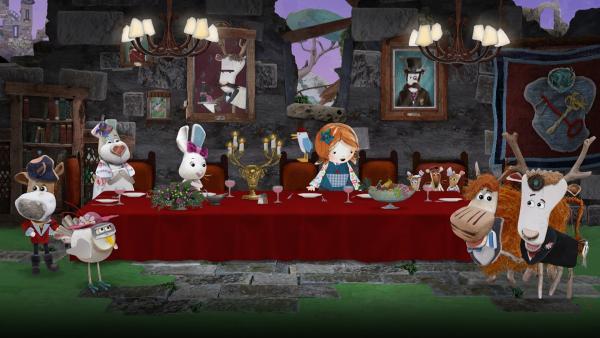 Lord von Hirsch hat seinen Tisch wunderbar gedeckt und alle freuen sich auf das Festessen. | Rechte: KiKA/Sixteen South