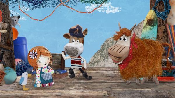 Salty erzählt Lily und Barne eine spannende Geschichte. Barne wäre zu gerne auch ein Seehund. | Rechte: KiKA/Sixteen South