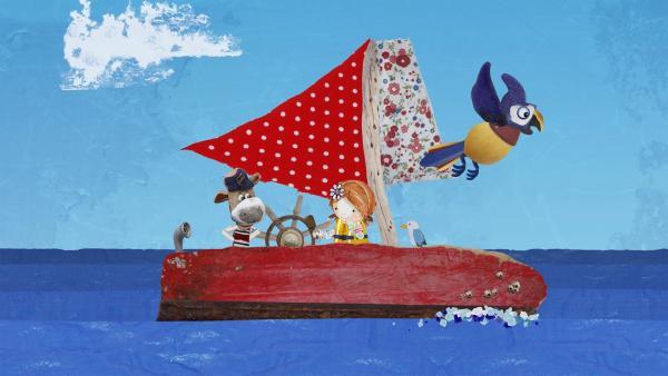 Lily und Salty entdecken einen sprechenden Papagei, der an Saltys Schiff vorbei, direkt auf Strandschatz Eilandzu fliegt. | Rechte: KiKA/Sixteen South