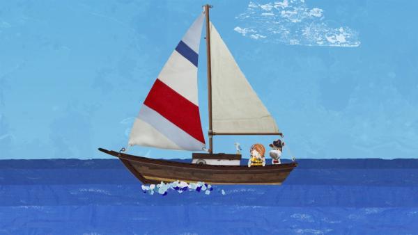 Salty ist begeistert, wie sanft sein neues Boot durch die Wellen gleitet.   Rechte: KiKA/Sixteen South
