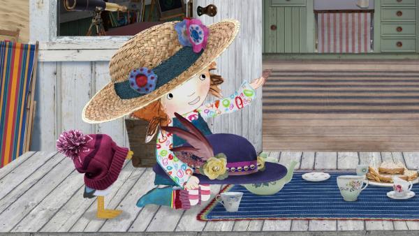 Lily gibt ihrem Vater einen schicken Hut, den er zu ihrer feinen Teegesellschaft tragen soll. | Rechte: KiKA/Sixteen South