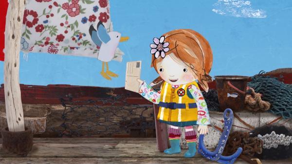 Beinahe wäre Lilys Postkarte von Bord geweht, aber Pelle bringt sie ihr zurück. | Rechte: KiKA/Sixteen South