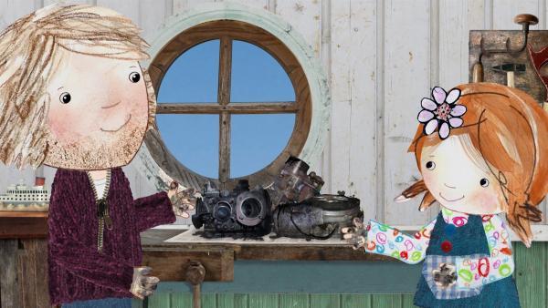 Lily und ihr Papa reparieren einen Motor und machen sich dabei ihre Hände ganz schön schmutzig. | Rechte: KiKA/Sixteen South
