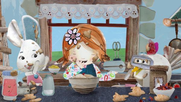 Lily, Flöckchen und Jette haben viel Spaß beim Backen der Hochzeitstorte.<br/> | Rechte: KiKA/Sixteen South