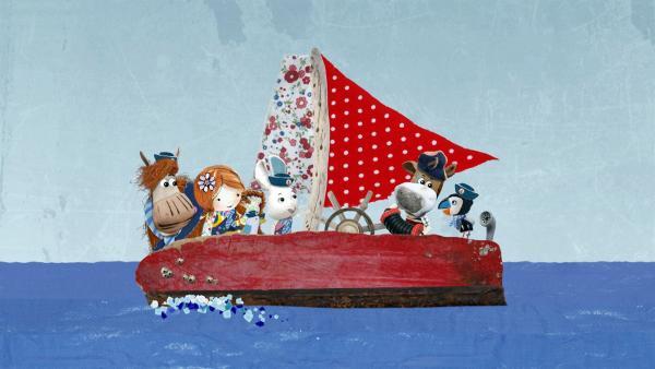 Salty stimmt auf der Delilah das Wellenfinderlied an und alle singen fröhlich mit. | Rechte: KiKA/Sixteen South