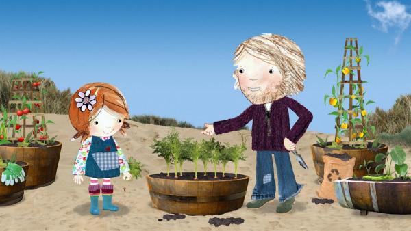 Zusammen mit ihrem Vater erntet Lily selbst angebautes Gemüse. Die Möhren sind allerdings noch sehr klein.  | Rechte: KiKA/Sixteen South