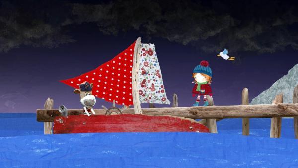 Lily und Pelle machen sich Sorgen, als Salty in den Sturm hinaus segelt, um Puffin von einer Steininsel zu retten. | Rechte: KiKA/Sixteen South