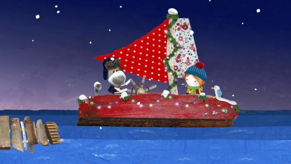 Salty hat seine Delilah bunt geschmückt hat. Sie ist so schön, wie ein Weihnachtsbaum, finden Lily und Pelle.   Rechte: KiKA/Sixteen South